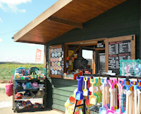 Brancaster Beach Kiosk, Brancaster, Norfolk - Cafes - The Kiosk provides all your seaside essentials, buckets and spades and a variety of beach goods. Serving hot and cold drinks, freshly made sandwiches, hot food and ice cream.